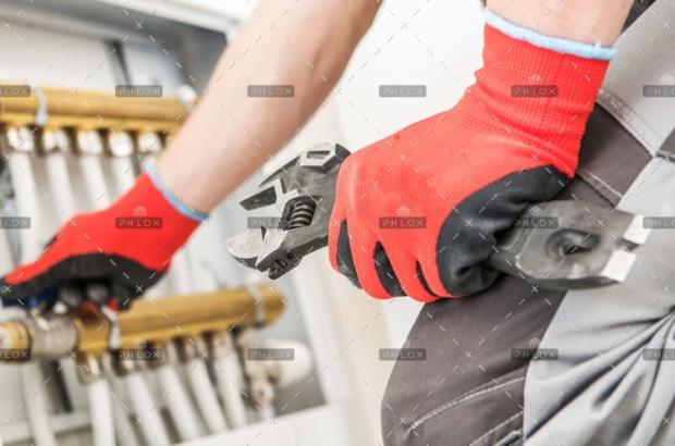 demo-attachment-137-op_technician-repairs-heating-JFGPBHA-scaled
